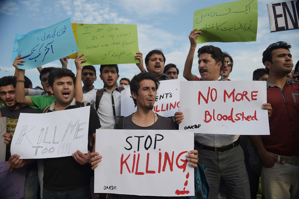 Demonstrators protest against the killing of the Shiite Ismaili minority, following the Shiite bus slaughter, in Islamabad on May 13, 2015. Photographer: Aamir Qureshi/AFP/Getty Images