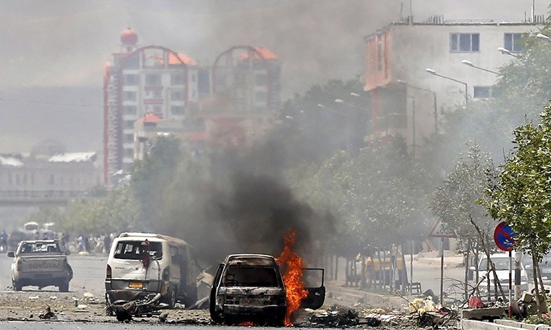 A vehicle is set on fire after a blast near the Afghan Parliament in Kabul.