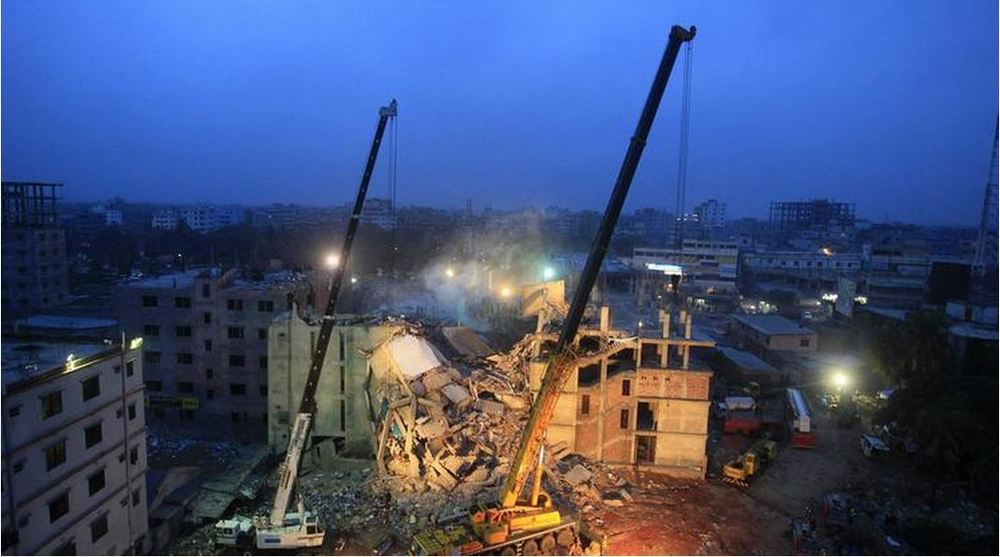 Cranes operated by Bangladeshi army personnel are at the scene days after the April 24, 2013, collapse of an eight-story building in Dhaka. Bangladeshi police on Monday charged the owner of the Rana Plaza factory complex and others with murder in the collapse that killed 1,137 people.  (AFP/Getty Images)