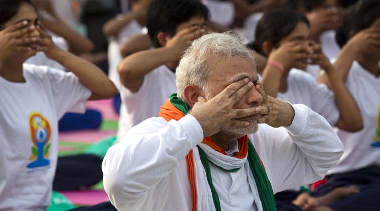 Prime Minister Narendra Modi performs yoga. (PTI photo)