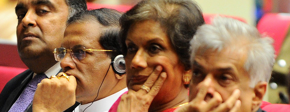 President Maithripala Sirisena (2nd L), India's top envoy Y. K. Sinha (L), Prime Minister Ranil Wickremesinghe (R) and former president Chandrika Kumaratunga (2nd R) look on during a ceremony in Colombo on July 5, 2015, as Kumaratunga marked her 70th birthday with a public lecture in Colombo. AFP PHOTO / Ishara S. KODIKARA