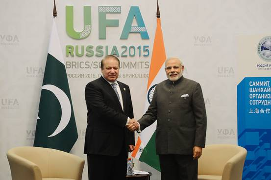 Pakistan Prime Minister Nawaz Sharif, left, shakes hands with Indian Prime Minister Narendra Modi on the sidelines at a summit of the Shanghai Cooperation Organization in the Russian city of Ufa. PHOTO: AGENCE FRANCE-PRESSE/GETTY IMAGES