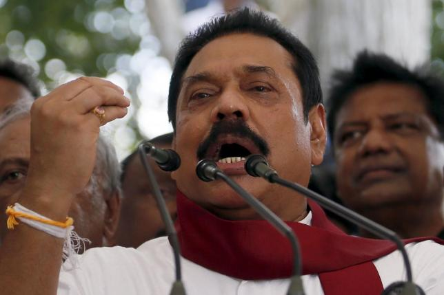 Former Sri Lankan president Mahinda Rajapaksa speaks to his supporters at his residence in Medamulana July 1, 2015. REUTERS/DINUKA LIYANAWATTE