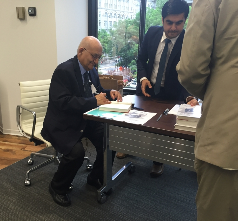 Dr. Sobhan signing a copy of his memoirs after a riveting talk.