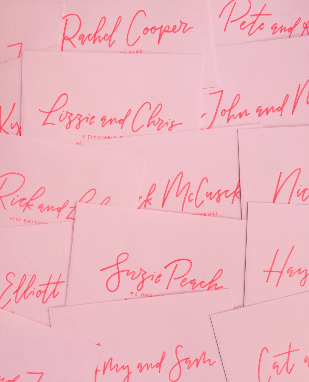 modern wedding envelope calligraphy onto pink envelopesjpg