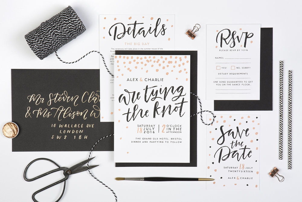 modern black and white wedding stationery with rose gold details