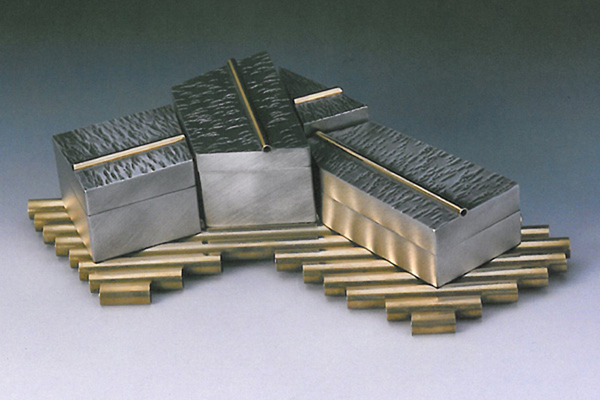 Four Box Puzzle  , 1998, pewter and brass, 2x10x7 inches