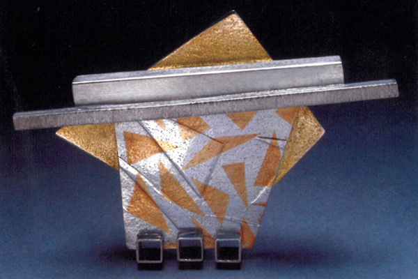 Pin , 1988, sterling silver, 18k gold and 24k gold overlay, 3.25x2.25x0.5 inches