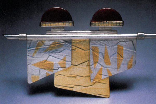 Pin  , 1988, sterling silver,18k gold, 24k gold overlay and red jasper, 5x3x0.5 inches