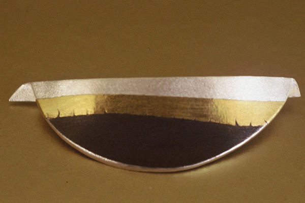 Pin  , 1985, sterling silver and 24K gold overlay