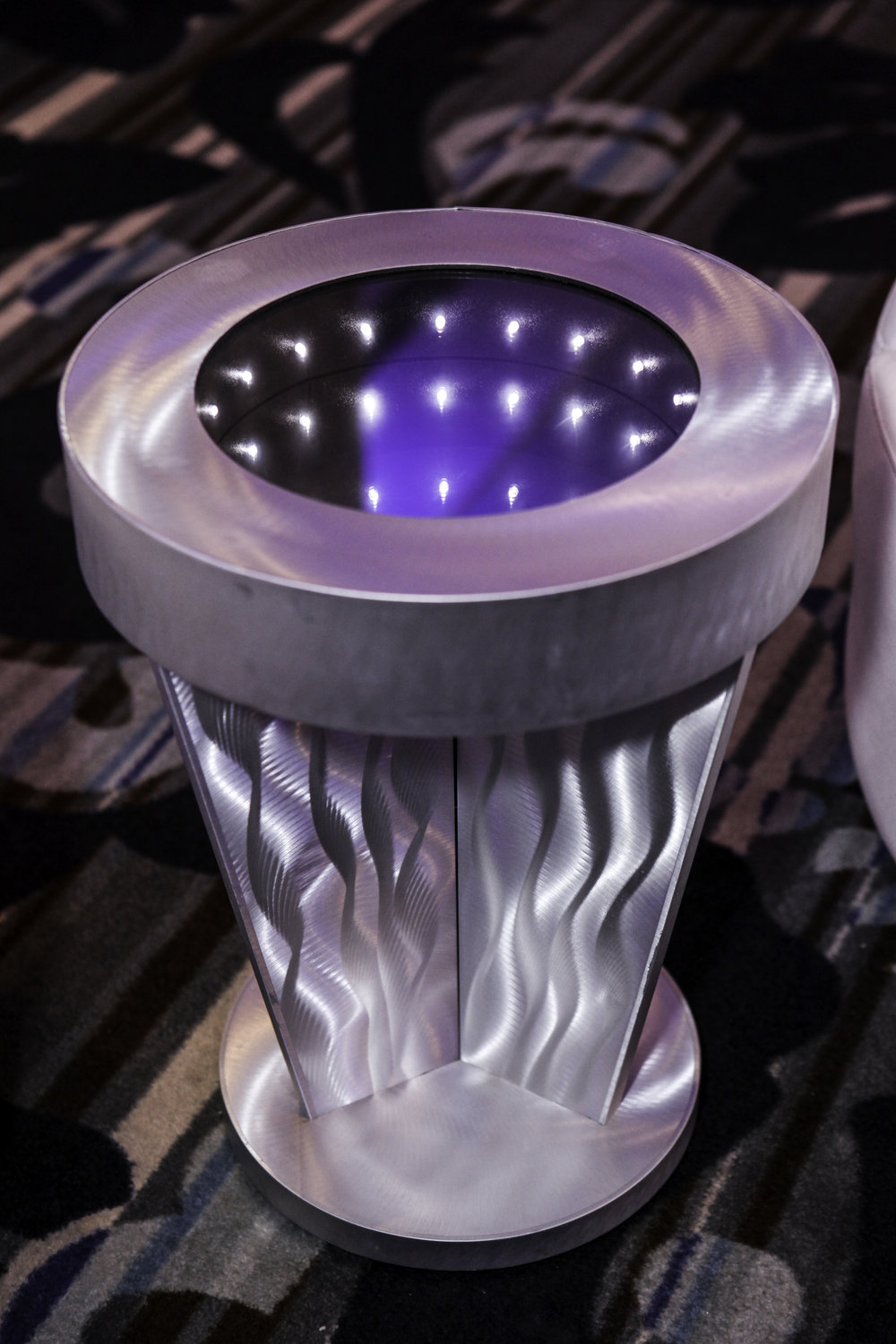 Table- Brushed Silver Pedestal Infinity Table_2.jpg