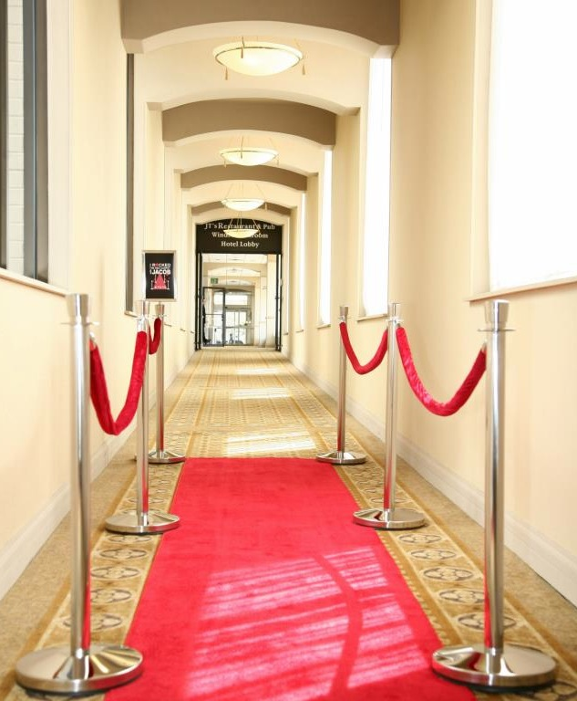 Custom Stanchion Sign and Red Carpet.jpg