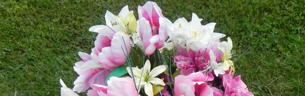 Burial plot monument flower arrangement
