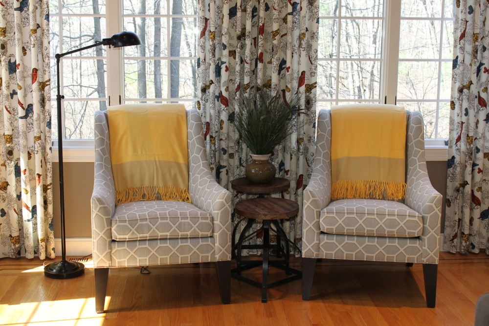 These chairs feature a custom fabric and leg finish.