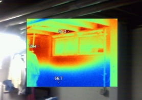 Un-insulated foundation walls allow energy transfer from hot to cold. This photo was taken in the summertime and shows outdoor heat radiating into the basement. During the winter months, basement heat will radiate outside.