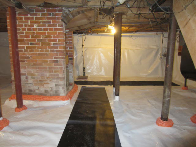 Vapor barrier over dirt floor