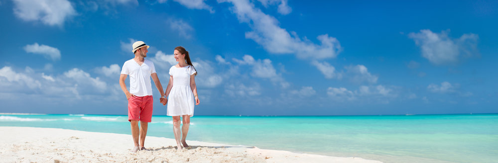 bigstock-Young-couple-tropical-at-beach-61567007.jpg