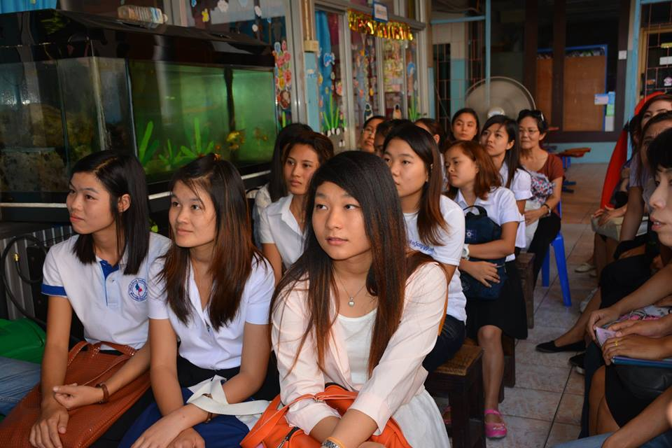 A group of young women in Burma eagerly listening on how to become a Wedu Rising Star.