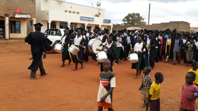 Friends of Orphans band marching at graduation