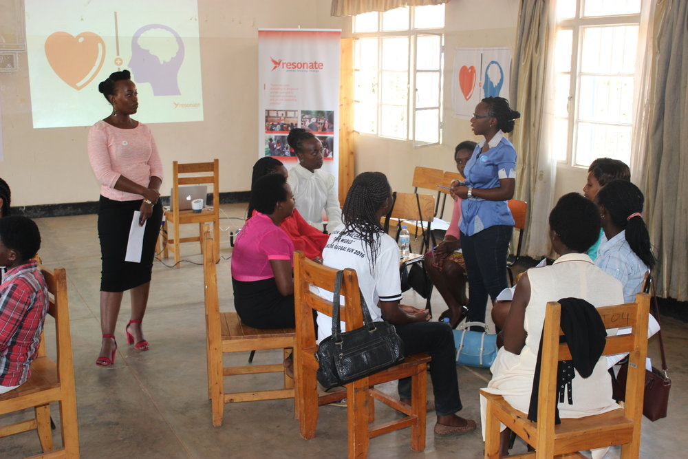 Training participants - engage in small group discussions with Resonate Trainer Benigne Mugwaneza (photo credit: Resonate)