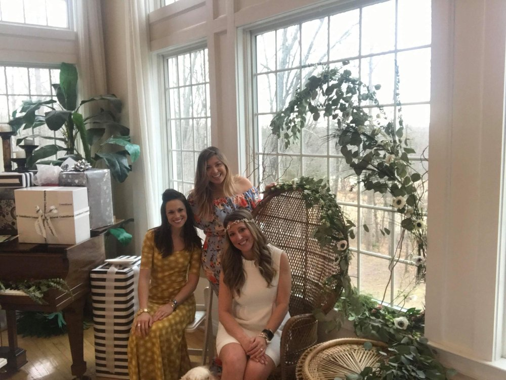 one of my bridesmaids, whitney, jeri/maide of honor, and me! check out that chair and greenery- isn'y it to die for?!
