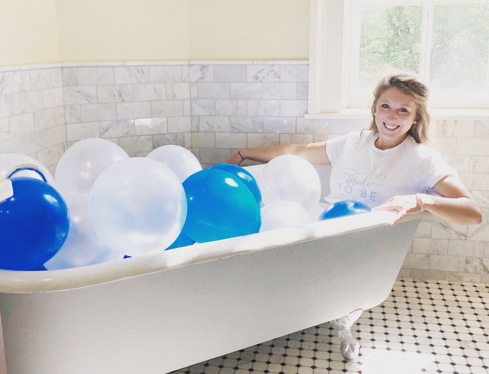 Because who doesn't hang out in a beautiful porcelain tub with balloons?!