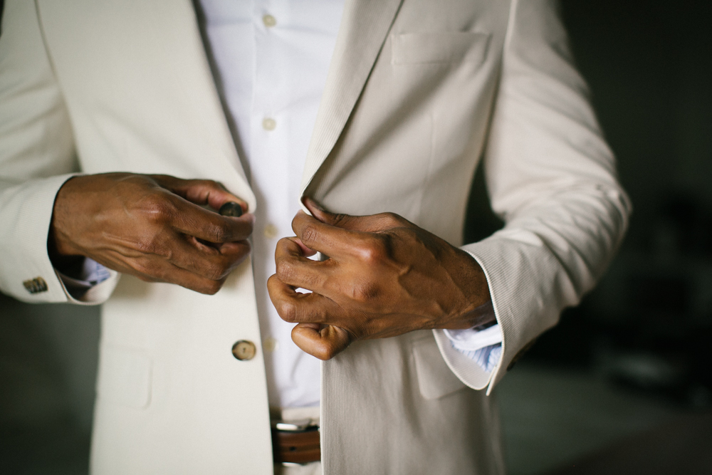 groom_buttoning_jacket