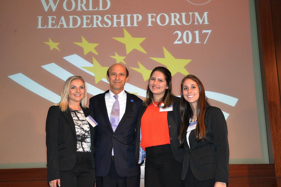 Jessica Malinowska, Maria Hasbun, and Alexa Menashe with FPA President Noel Lateef at the World Leadership Forum in New York City.