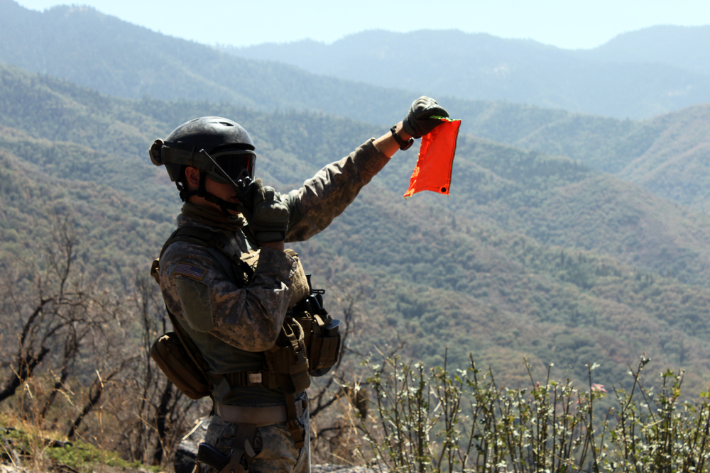 A California National Guard member on an operation to remove trash and irrigation lines from illegal grow sites.  Photo: California National Guard.