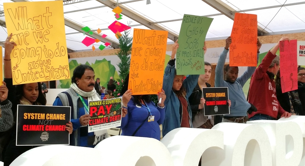Protesters at COP 21 target developed countries in demanding reform.  Photo: Ryan Stoa.