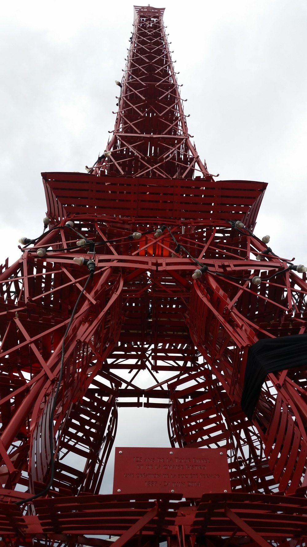 A replica of the Eiffel Tower made from bistro chairs stands at the COP 21 conference venue.  Photo: Ryan Stoa.
