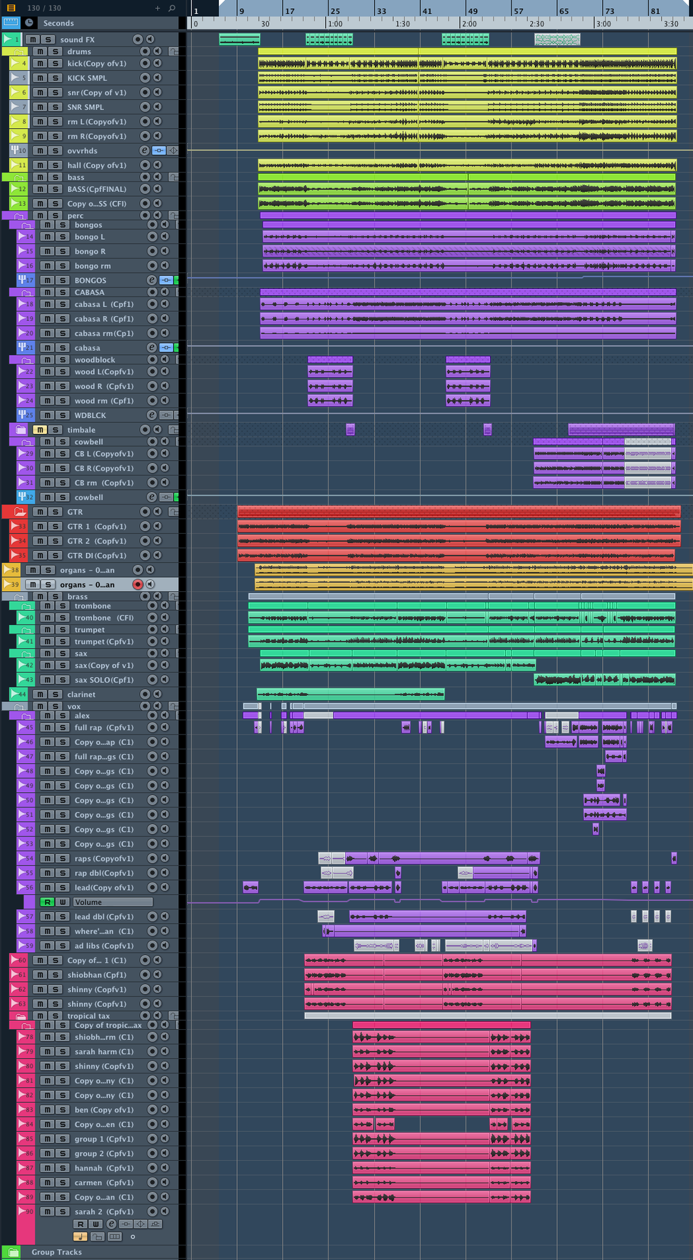 The Cubase project screen for Tropical Tax Haven. From top to bottom:  AQUA: ambient Jungle sounds YELLOW: drums (note Kick and Snare sample tracks to enhance the live sounds GREEN: Bass guitar (one DI and one reamped PURPLE: Percussion (L and R and ROOM for each instrument)  Bongos/Cabasa/Woodblock/Cowbell RED: Guitar ORANGE: Organ (two midi organs mixed together AQUA: Brass. Trombone/Trumpet/Sax PURPLE: Alex's vocals. Note the rap hype vocals to the right hand side here. PINK: Backing Vocals