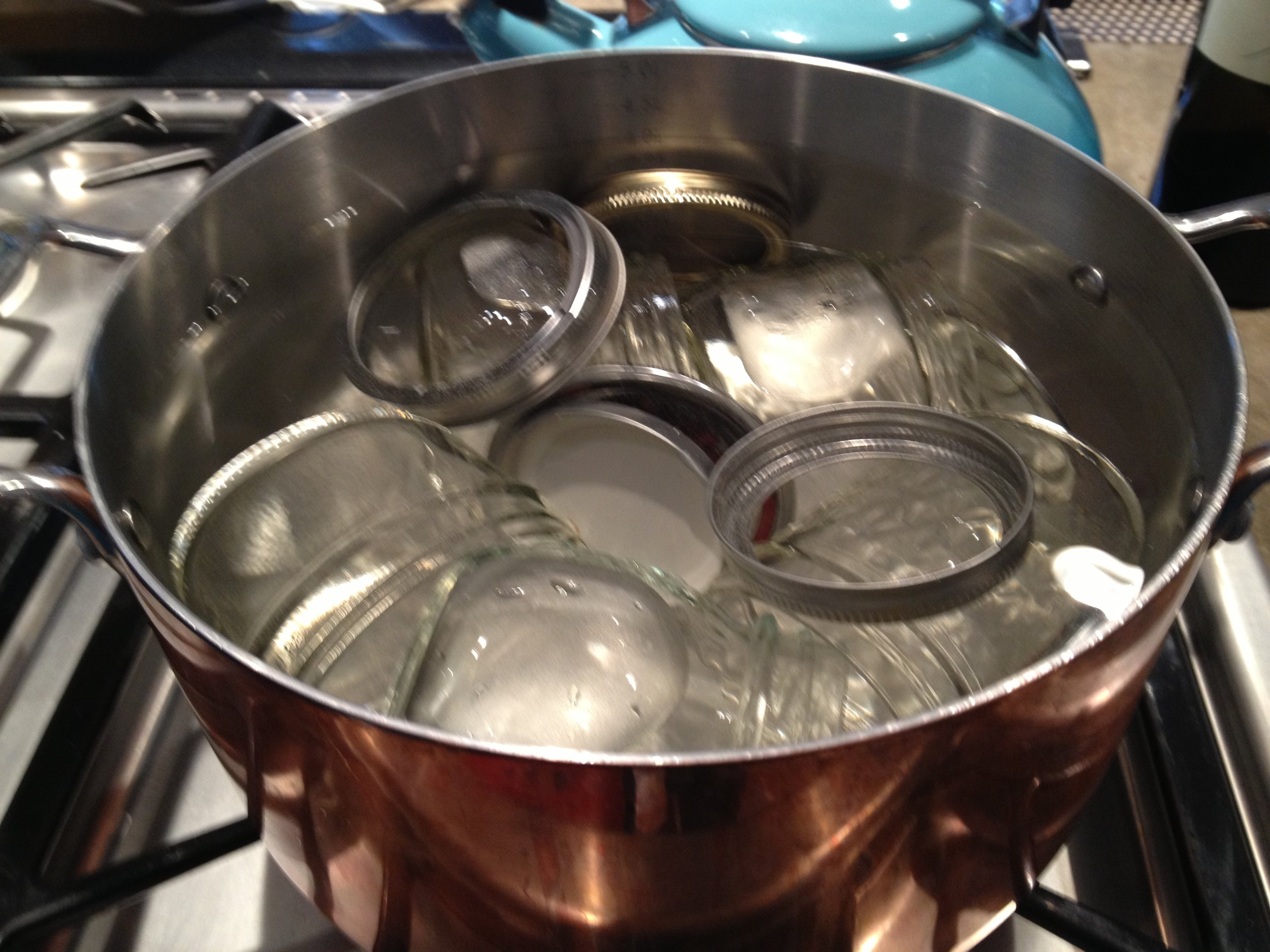 Sterilizing the jars in boiling water