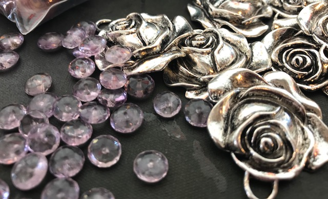 Each packet will receive 2 amethyst beads and one pewter rose