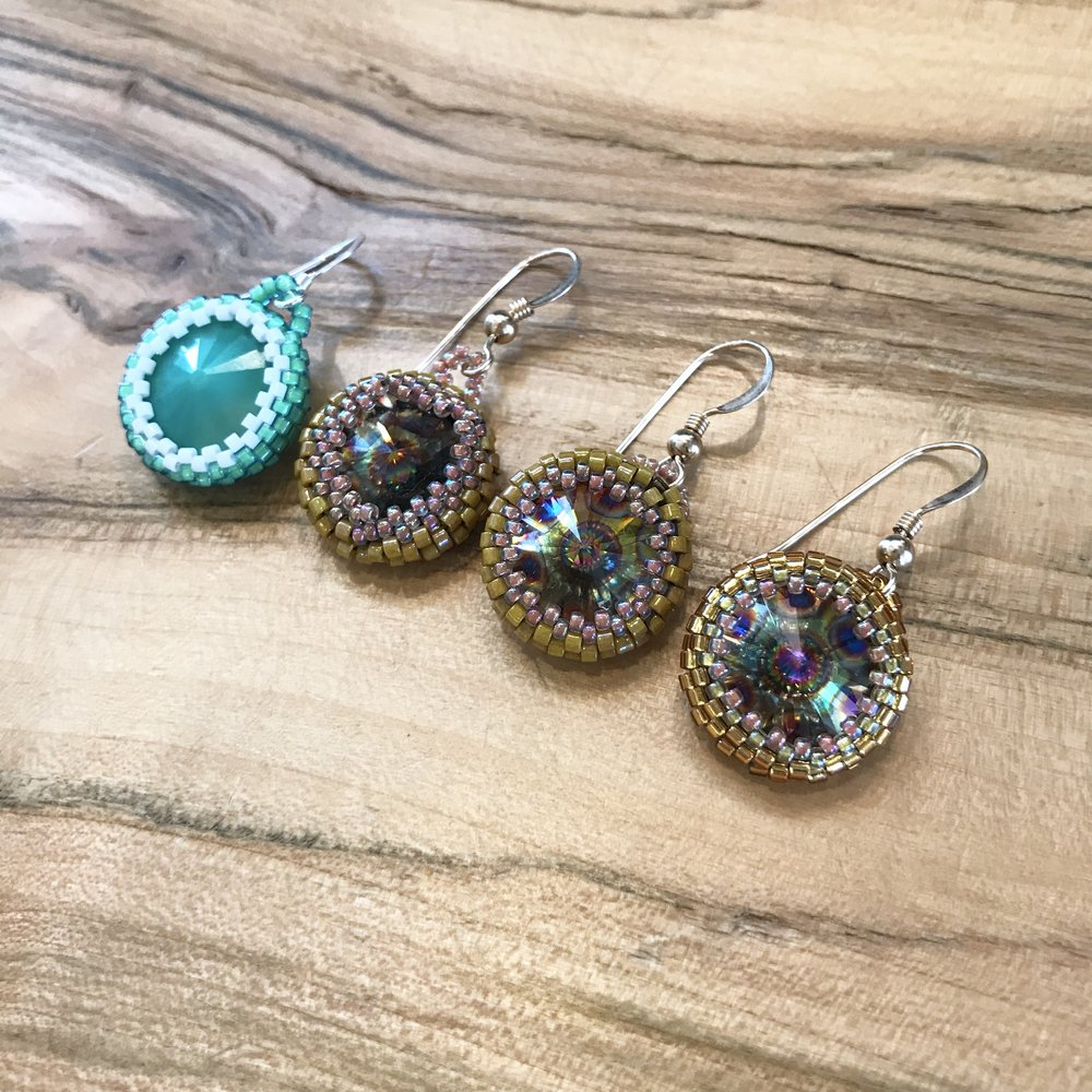 "All beading/wire class instruction is FREE with the purchase of materials. If you have all of your materials from home then classes are $15/person. You will need to pick out your materials upon registration so be sure to leave time. Once registered you will receive 20% off that day and the day of the class. Sweet!  Join us for this excellent beading workshop. Students will learn the bead weaving technique of Peyote Stitch. They will create a pattern that weaves around a beautiful Swarovski or Matubo Rivoli to create a woven bezel. When finished the stitch will create the perfect pair of earrings. Students will have time to complete one earring in this class and have plenty of supplies to finish the second one at home.  Instruction is free however there is a Bead Kit required for this workshop and that is $25. It includes all the supplies listed below.   Registration is required.   Please call us at  406-543-0018  or come by the shop to register. Once registered students will receive a 20% discount that is good on all regular priced merchandise for thirty days!   This class includes all supplies needed to complete one pair of earrings. See list below:  One tube size 11/0 Delica Size 15/0 Delicas Fire Line Beading Needles One pair of earwires One pair of Swarovski Rivolis Written Directions with photos  Registration is required 48 hours in advance. Please call or come by to register, 406-543-0018. Please note we require a credit card on file to register for classes when registering over the phone. Your card will not be charged unless you are a ""no show"" then you will be charged a $15 non-refundable fee. All cancellations must be made 24 hours in advance. Thank you."