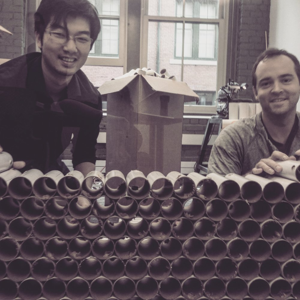 Card Board Tubes Everywhere! Our dear Erick and James having a fun afternoon with band saws and card board tubes