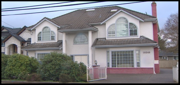 Convicted immigration fraudster Xun 'Sunny' Wang used his own home in Richmond as a fake address for several fictitious companies. (Mike Zimmer/CBC )