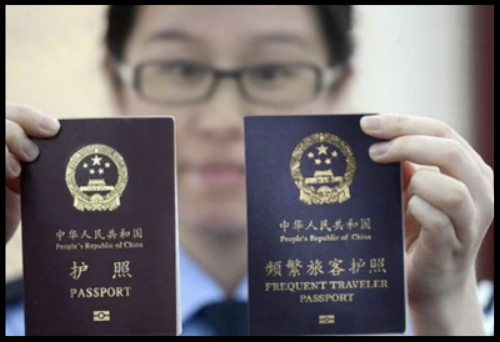 "A new ""frequent traveler passport"" next to the ordinary Chinese passport."