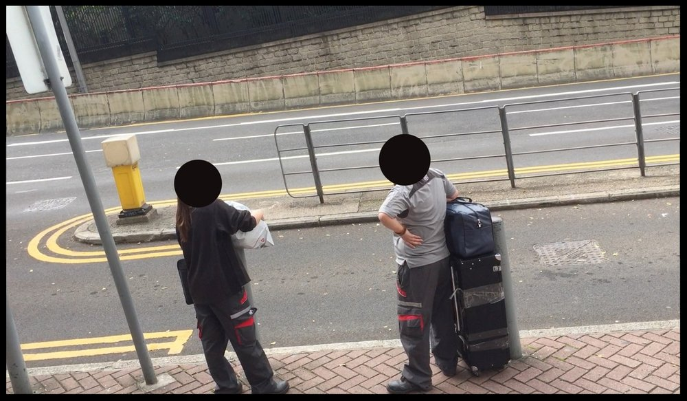 Two S.F. Express couriers was seen collecting passports from the consulate building in Central,unaccompanied by security guards and in full view of the public.  Photo: FactWire