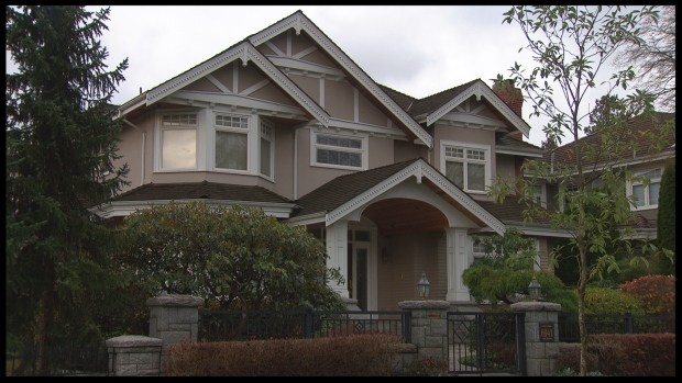 Pei Jia Li, a permanent resident who has fraudulent entry and exit stamps in his passport, lives in this $7-million home in Kerrisdale, an affluent neighbourhood in Vancouver.  (Harold Dupuis/CBC )