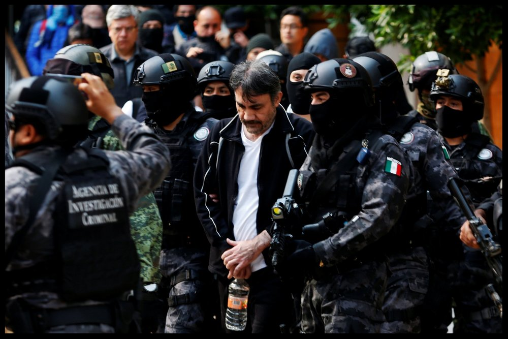 "Accused drug kingpin Damaso Lopez, nicknamed ""The Graduate"", is escorted by police in Mexico City on May 2, 2017.Carlos Jasso/Reuters"
