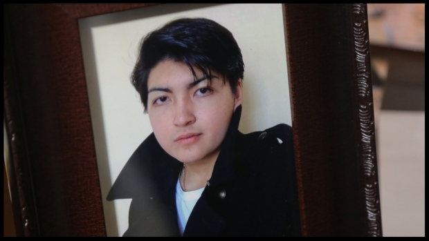 Karim Baratov is pictured in a framed photo at his parents' home. (Adam Carter/CBC)