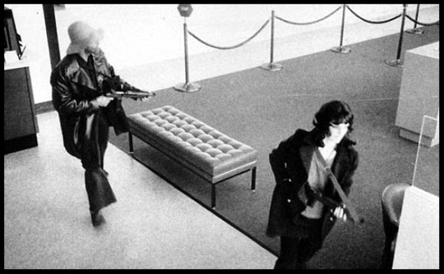 'Terrorists': this infamous photo shows newspaper heiress Patty Hearst wielding a gun during a bank robbery in California in 1975