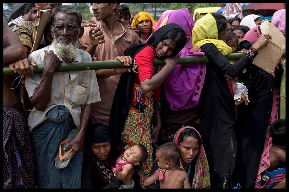 Rohingya refugees wait in a line for food aid at the Balukhali refugee camp in Cox's Bazar, Bangladesh on 25 September 2017.  KM Asad/NurPhoto/Sipa USA/PA Images.