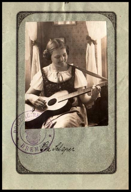 This 1921 German passport shows a young woman with her guitar.
