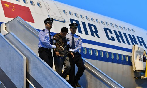 Liu Changkai, one of China's most wanted fugitives, returns to the Chinese mainland to turn himself in to police.  Photo: VCG