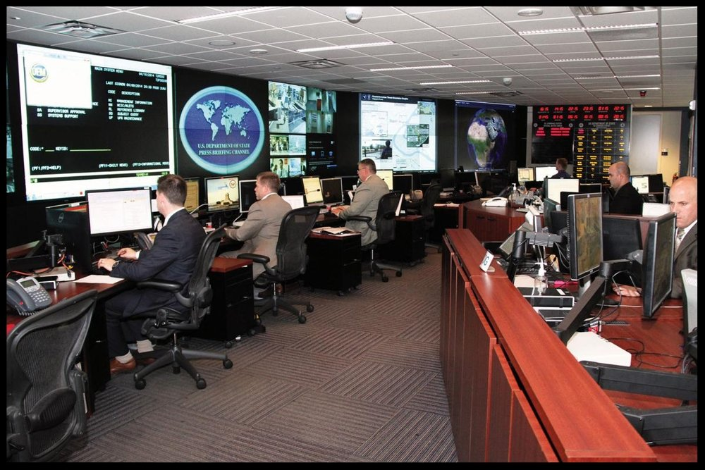 Special agents monitor world events and overseas security from inside the Diplomatic Security Command Center in April 2014. Today the Command Center is a 24/7/365 facility with the ability to electronically monitor all U.S. diplomatic facilities around the globe. Department of State