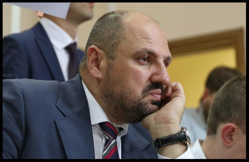 A lawmaker from President Petro Poroshenko's Bloc Borys Rozenblat listens his lawyer in Kyiv's Solomyansky Court on July 18.