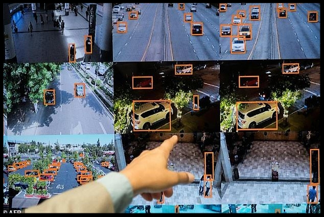 A display shows a vehicle and person recognition system for law enforcement during the NVIDIA GPU Technology Conference, which showcases artificial intelligence, deep learning, virtual reality and autonomous machines