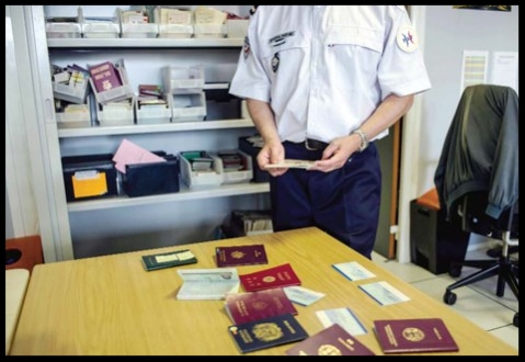 PARIS: French expert of the French Office of False Documents and Identity Fraud, Laurent Gauthier, shows false passports during an interview with The Associated Press. — AP